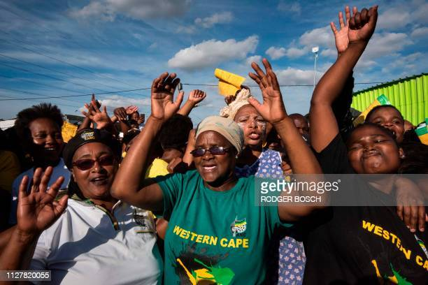 Supporters of the ruling party African National Congress wait for South African President prior to his visit of an informal settlement in Khayelitsha...