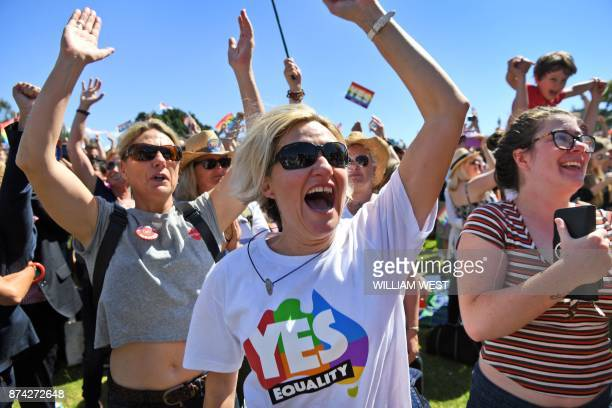 Supporters of the samesex marriage 'Yes' vote gather to celebrate the announcement in a Sydney park on November 15 2017 Australians voted in favour...