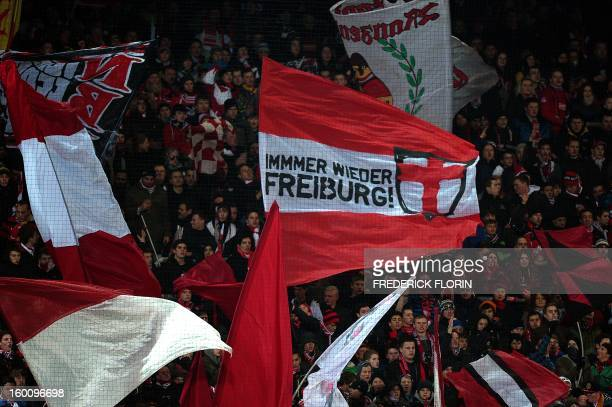 Supporters of the SC Freiburg wave flags before the German first division Bundesliga football match SC Freiburg vs Bayer 04 Leverkusen in Freiburg,...
