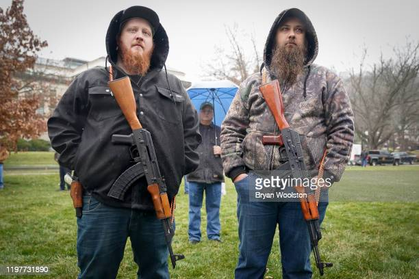 Supporters of the Second Amendment carry semiautomatic rifles at the State Capitol during a rally on January 31 2020 in Frankfort Kentucky Advocates...