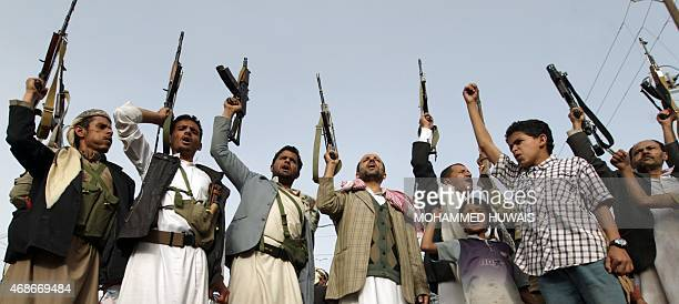 Supporters of the Shiite Huthi militia brandish their weapons in the Yemeni capital Sanaa on April 5 during a demonstration against Saudiled...