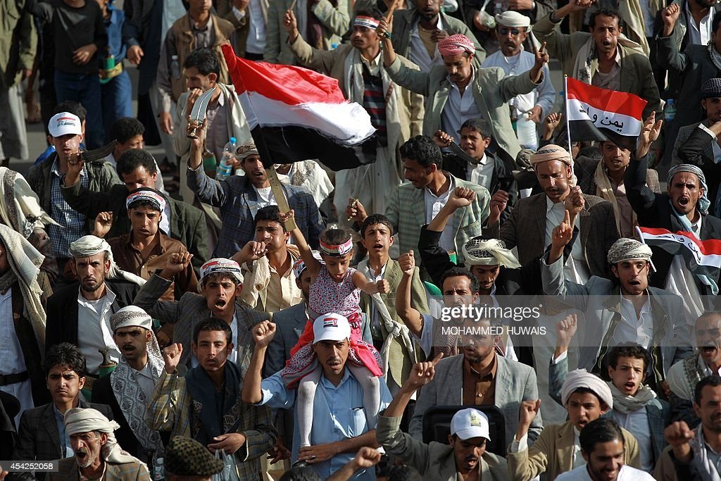 Supporters of the Shiite Huthi movement hold national flags during an anti-government protest on August 27, 2014 in the Yemeni capital Sanaa. Yemeni President Abdrabuh Mansur Hadi urged Shiite rebel leader Abdulmalik al-Huthi on August 26 to withdraw his militant followers from the capital following the failure of negotiations on their demands.