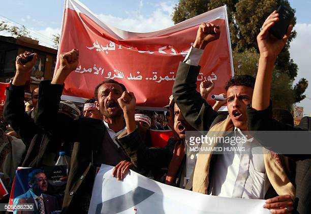 Supporters of the Shiite Huthi movement shout slogans during a rally commemorating the fifth anniversary of the 2011 Arab Spring uprising that...