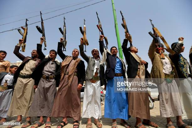 TOPSHOT Supporters of the Shiite Yemeni Huthis demonstrate in the capital Sanaa on 25 June 2018 to show their solidarity with fellow Huthis engaged...