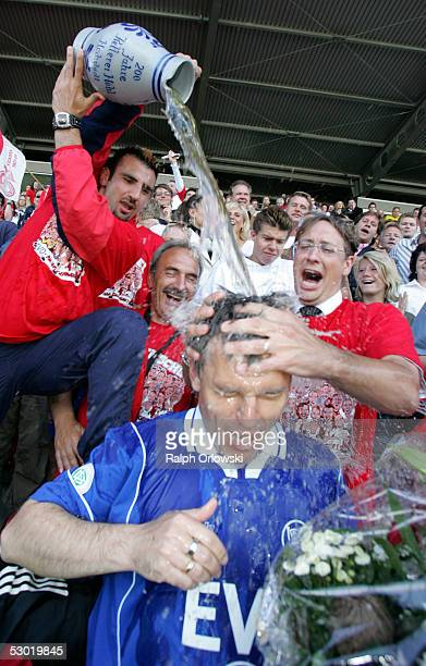 Supporters of the soccer team Kickers Offenbach soak HansJuergen Boysen the coach of the team after the match of the Third Bundesliga between Mainz...