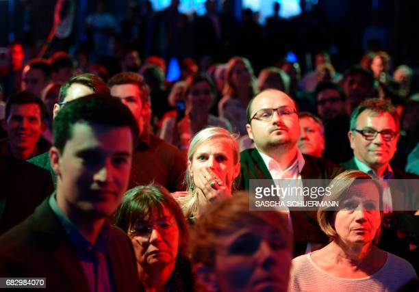 Supporters of the Social Democratic Party react on the announcement of the first results on May 14 2017 in Duesseldorf western Germany during North...