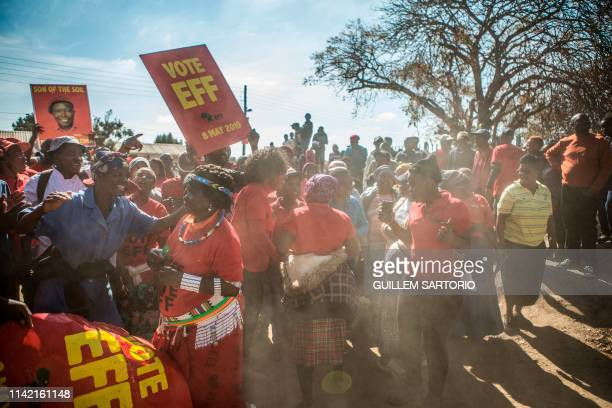 Supporters of the South African opposition party Economic Freedom Fighters wait for leader Julius Malema at a polling station in the Sheshego...