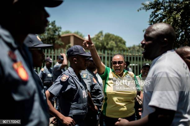 Supporters of the South African ruling party African National congress demonstrate against the language and admission policies outside the Horskool...