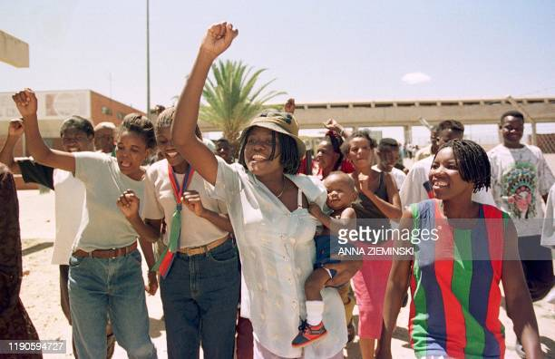 Supporters of the South West Africa People's Organization sing and dance as they arrive 28 November 1999 at the party's final election rally, which...
