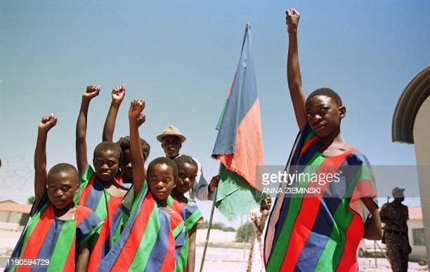 Supporters of the South West African People's Organization raise their fists as they arrive 28 November 1999 at the party's final election rally in...