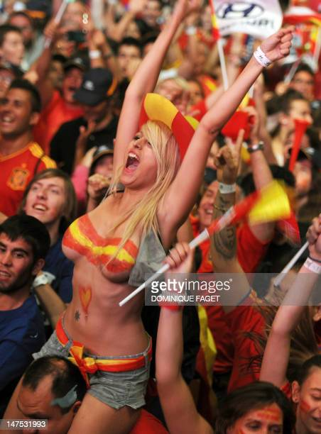 Supporters of the Spanish national football team celebrate on July 1, 2012 in Madrid after their team won the final match of the Euro 2012 football...