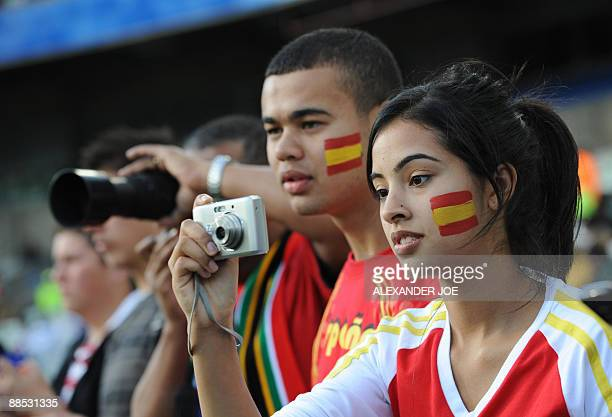 Supporters of the Spanish team take pictures in the stands before the Fifa Confederations Cup football match Spain vs Iraq on June 17 2009 at the...