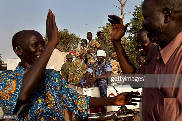 Supporters of the Sudan People's Liberation Movement candidate Taban Deng celebrate following the announcement that he had retained his post as...