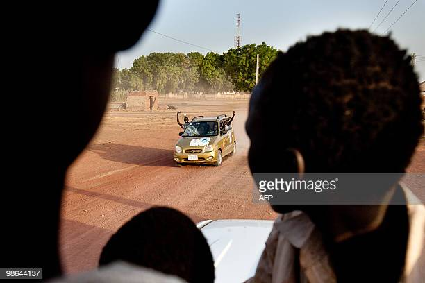 Supporters of the Sudan People's Liberation Movement candidate Taban Deng celebrate in the streets following the announcement that he had retained...