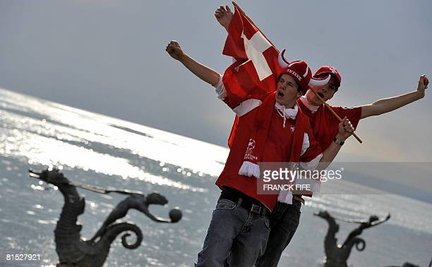 Supporters of the Swiss team wave a Swiss flag few hours before the beginning of the Euro 2008 football group A match between Switzerland and Turkey...