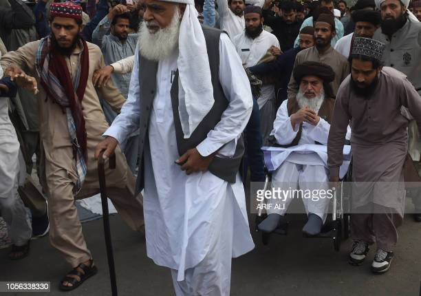 Supporters Of The Tehreekelabaik Pakistan A Hardline Religious Political Party Escort Their Leader Khadim Hussain Rizvi