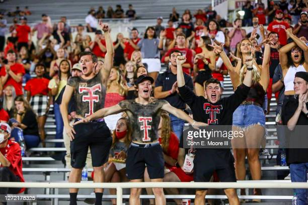 Supporters of the Texas Tech Red Raiders celebrate after a failed fourth down attempt by the Houston Baptist Huskies during the first half of the...