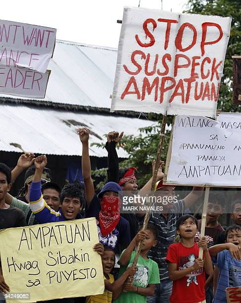 Supporters of the the powerful Ampatuan family rally to their defence while dozen mayors and other local officials from three provinces all allies of...