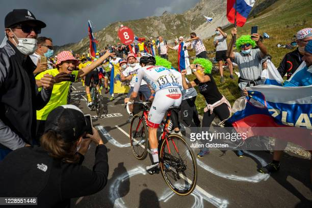 Supporters of the Tour de France cycling event cheering Primos Roglic and Tadej Pogacar in the Col de la Loze on September 16, 2020 in Meribel,...