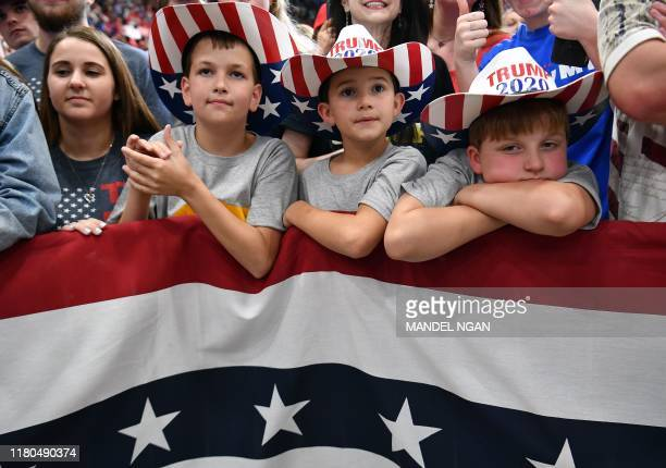"""Supporters of the US president and children wearing """"Trump 2020"""" hats attend a rally at the Monroe Civic Center in Monroe, Louisiana on November 6,..."""