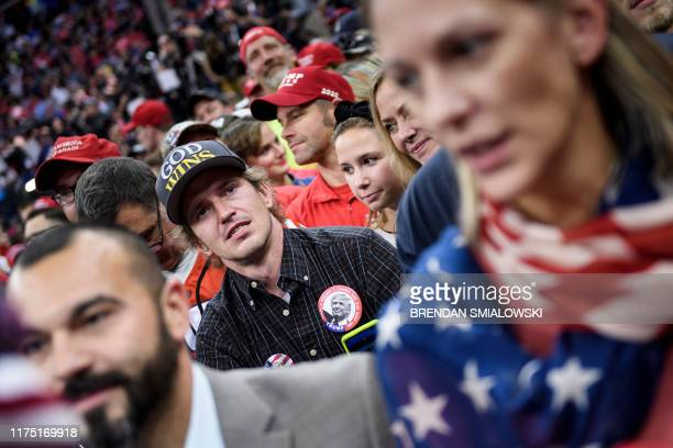 """Supporters of the US president attend a """"Keep America Great"""" rally at the Target Center in Minneapolis, Minnesota on October 10, 2019."""