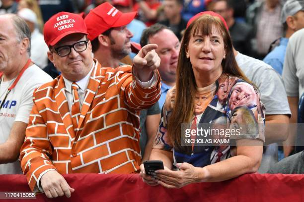 """Supporters of the US president attend a """"Keep America Great"""" rally at the American Airlines Center in Dallas, Texas on October 17, 2019."""