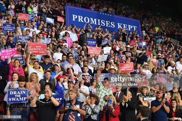 Supporters of the US president cheer and hold signs during a Make America Great Again rally in Billings Montana on September 6 2018