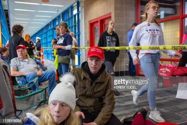 """Supporters of the US president gather outside the Target Center in Minneapolis, Minnesota, ahead of a """"Keep America Great"""" rally on October 10, 2019."""