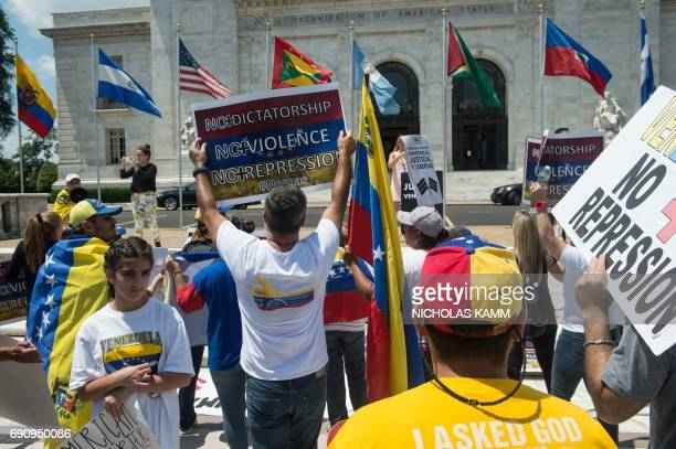 Supporters of the Venezuelan opposition demonstrate in front of the Organization of American States headquarters in Washington DC on May 31 2017...