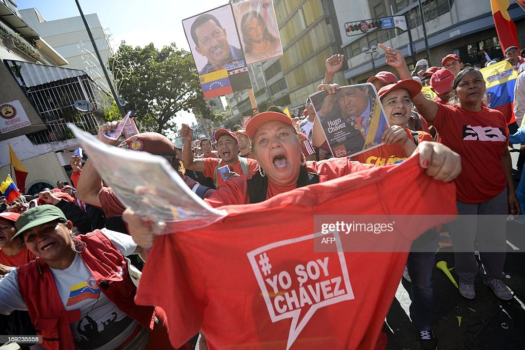 Supporters of the Venezuelan President Hugo Chavez shout slogans outside Miraflores Presidential Palace in Caracas during a meeting on January 10, 2013. With Chavez ailing and absent, Venezuela's leftist government launches a new presidential term with a display of popular support on the day he was to be inaugurated. The Supreme Court cleared the cancer-stricken president to indefinitely postpone his re-inauguration and said his existing administration could remain in office until he is well enough to take the oath.AFP PHOTO/Leo RAMIREZ