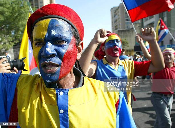 Supporters of the venezuelen president Hugo Chavez shout slogans during a protest against the Supreme Justice Tribunal in Caracas 14 August 2002AFP...