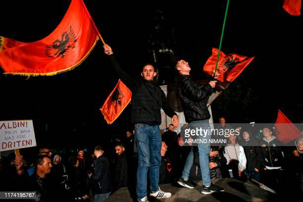 Supporters of the Vetevendosje Party and parliamentary elections candidate for Prime Minister Albin Kurti celebrate their victory in Pristina on...