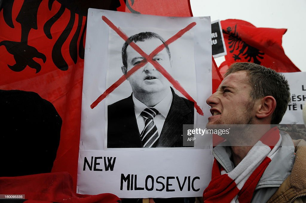 Supporters of the 'Vetevendosje' (Selfdetermination) shout slogans while carrying a portrait of Serbian Prime Minister Ivica Dacic at a protest in Pristina on January 26, 2013 to support the Albanians in the Valley of Presevo against the removal of the martyrs memorial by the Serb gendarmerie in Presevo. More than 3,000 ethnic Albanians protested on January 21, 2013 against Belgrade's removal of a memorial honouring their guerrillas and demanded 'demilitarisation' of this tense ethnically-mixed southern region of Serbia.