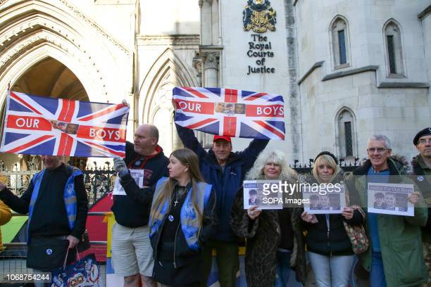 Supporters of the victims are seen with flags and portraits outside the Royal Courts Of Justice London Supporters of Josh Kennedy aged 16 Harry Rice...