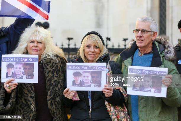 Supporters of the victims are seen with portraits of the victims outside the Royal Courts Of Justice London Supporters of Josh Kennedy aged 16 Harry...