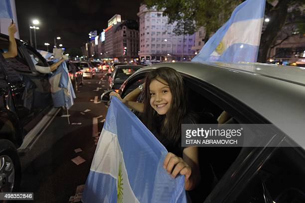 Supporters of the victorious presidential hopeful of the Cambiemos party Mauricio Macri celebrate his win in Buenos Aires on November 22 2015 Leftist...