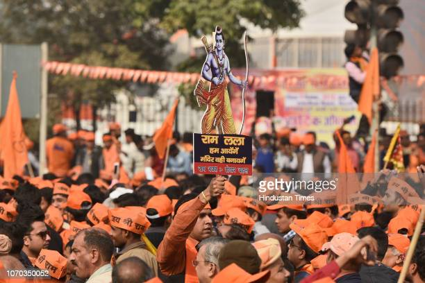 Supporters of the Vishva Hindu Parishad arrive to attend Dharma Sabha or a religious congregation organised by the VHP at Ramlila Ground to press...