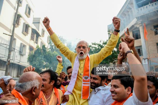 Supporters of the Vishwa Hindu Parishad organisation celebrate the Indian Supreme Court's verdict on disputed religious site in Ayodhya awarded to...