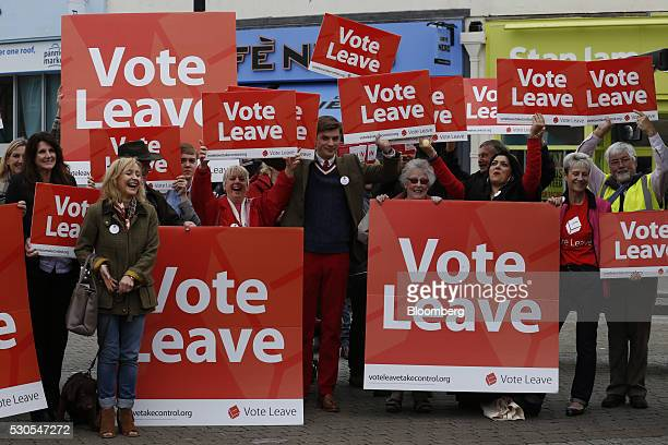 Supporters of the Vote Leave campaign cheer as they wait for Boris Johnson the former mayor of London during the first day of a nationwide bus tour...