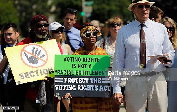 Supporters of the Voting Rights Act listen to speakers discussing today's rulings outside the U.S. Supreme Court building on June 25, 2013 in...