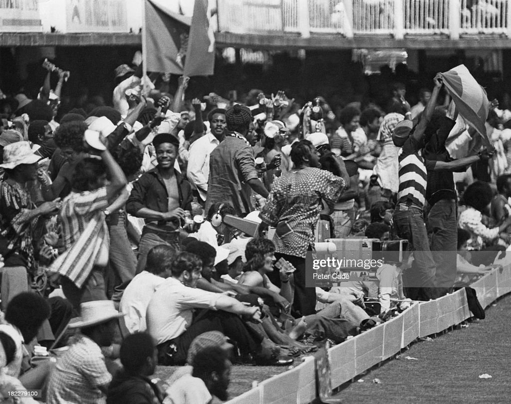 Supporters of the West Indies during the Cricket World Cup Final against Australia at Lord's Cricket Ground, London, 21st June 1975. A TV camera crew is filming the action (centre). The West Indies beat Australia by 17 runs.