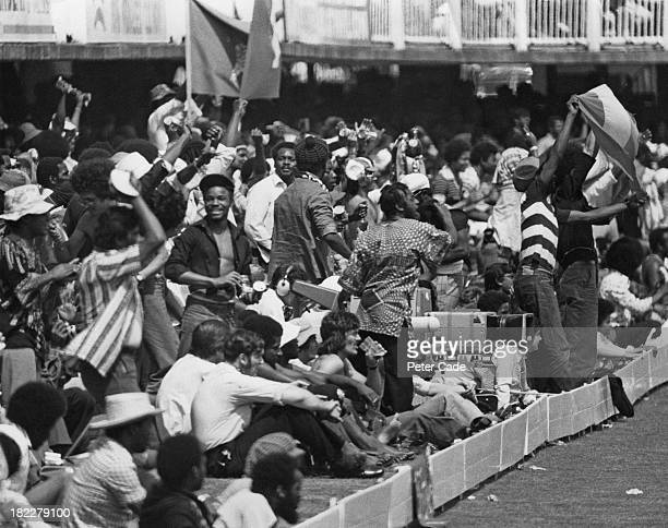 Supporters of the West Indies during the Cricket World Cup Final against Australia at Lord's Cricket Ground, London, 21st June 1975. A TV camera crew...
