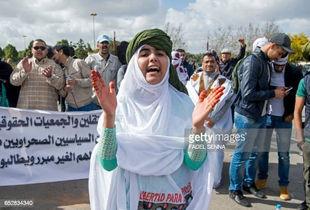 Supporters of the Western Sahara's Polisario Front shout slogans during a demonstration outside the court in Sale on March 13 in support of the 25...