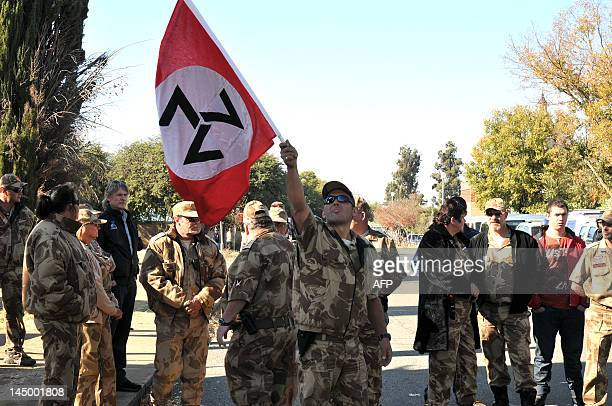 Supporters of the white supremacist Afrikaner Resistance Movement stand outside the Ventersdorp Magistrate court on May 22 2012 as they wait for the...