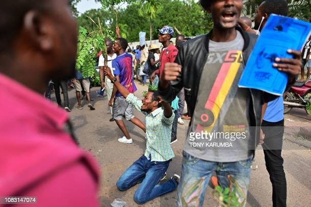 Supporters of the winner of December 30 presidential election Felix Tshisekedi react on January 15 2019 in Kinshasa to radio broadcasts of the...