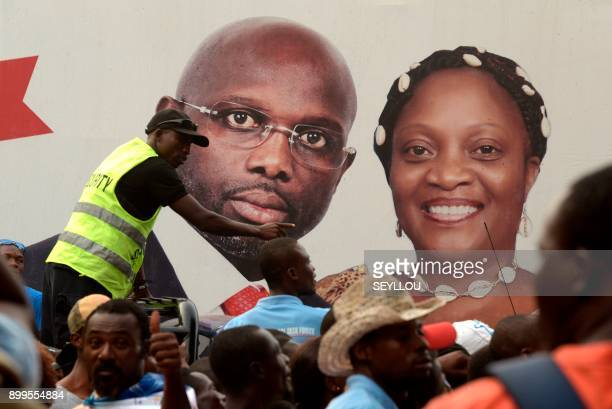 Supporters of the winner of Liberia's presidential elections George Weah celebrate after the proclamation of the second round results on December 29...