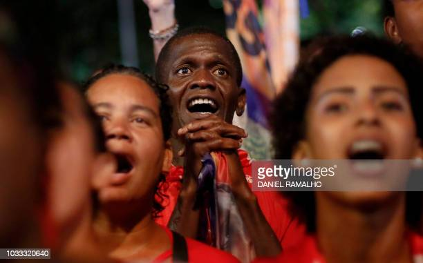 Supporters of the Workers Party take part in a rally of Brazilian presidential candidate Fernando Haddad at Cinelandia Square in Rio de Janeiro...