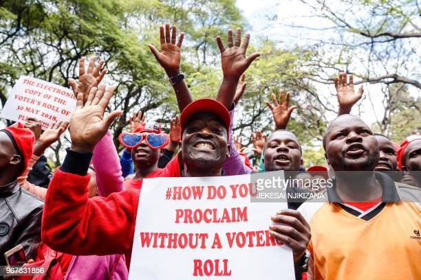 Supporters of the Zimbabwean opposition alliance parties hold banners and chant slogans as they take part in a demonstration called by the Zimbabwean...
