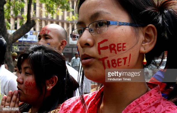 Supporters of Tibetan Youth Congress during a silent rally demanding a free Tibet on their Uprising Day in Siliguri on Monday
