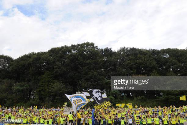 Supporters of Tochigi SC cheer prior to the J.League J2 match between Tochigi SC and FC Ryukyu at Tochigi Green Stadium on October 20, 2019 in...